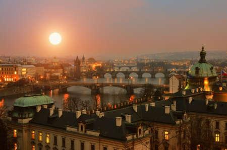 evening church: Panoramic view on Prague Bridges at sunset Stock Photo