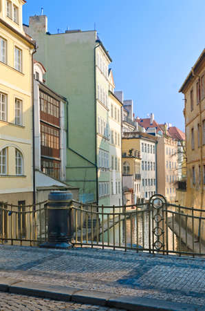 Colorful houses and Certovka (the Davils Stream) with Kampa Island on the right, Prague, Czech Republic photo