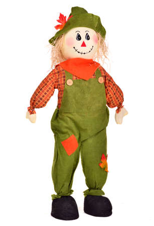 Fall Decoration Of A Stuffed Scarecrow For Thanksgiving Celebrations, Isolated on white background