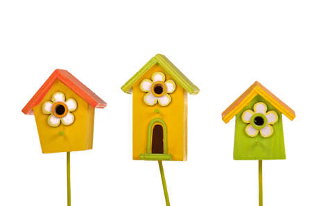 economic rent: Three colorful bright starling-houses isolated on white background