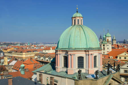 prague: Prague roof tops panorama with The Church of Saint Francis of Assisi in front, Prague. Stock Photo