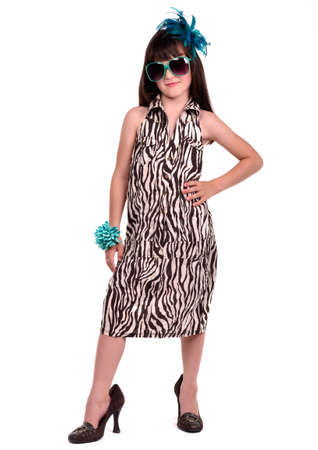 too: Beautiful female child wearing her mothers evening dress which is too big for her Stock Photo