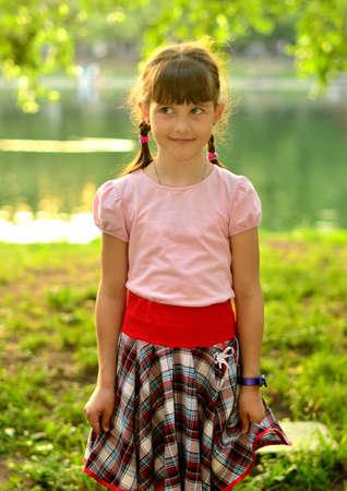 Lovely smiling girl in sunny park photo