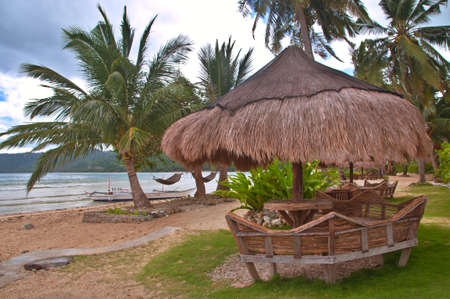 Hut on an Exotic Tropical Beach photo
