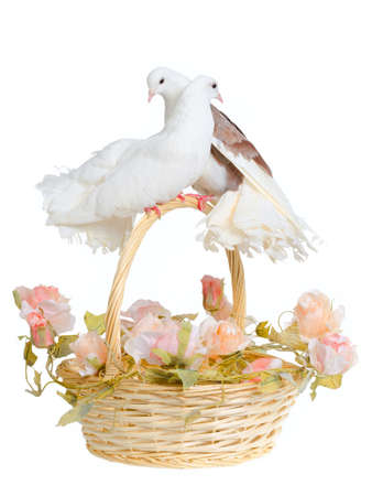 Wedding basket with pink flowers and decorative doves Stock Photo