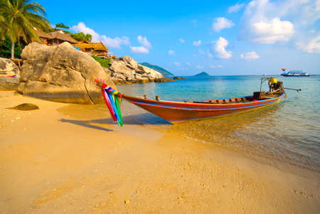 Longtail boat on a tropical beach photo
