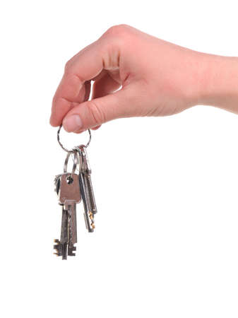 Human hand with a bunch of keys, isolated on white background. photo