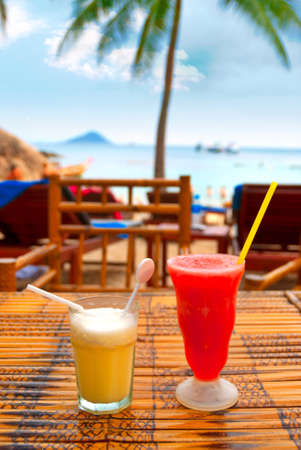 Two cocktails on a beach table photo