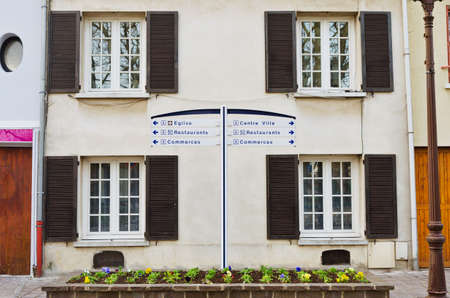 European apartment building with open shutters, France photo
