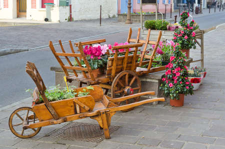 European town street with wooden flower pot, France photo