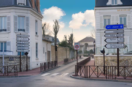 french doors: Small european street with lovely houses and street sign, France