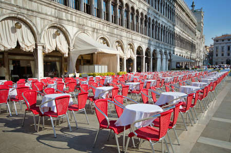 Empty bistro tables on San Marco square, Venice , Italy