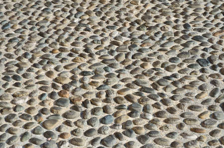 karesansui: Textured cobbled wall background with stones and cement