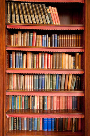 Bookcase: Old books on a shelf Editorial