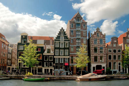 cities: Amsterdam canals and typical houses with clear spring sky