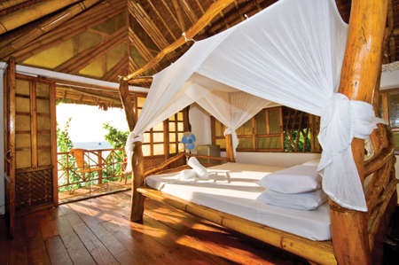 hotel balcony: Wooden Cottage with Perfect Tropical Seaview Editorial