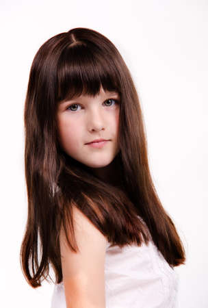 petite: portrait of beautiful little girl with luxuriant healthy long hair Stock Photo