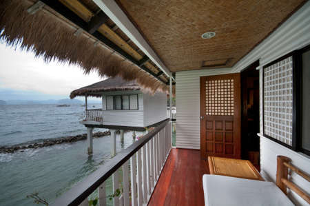 On the balcony of a tropical seaside resort villa.