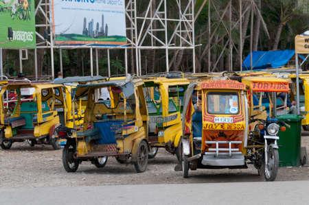 tricycle: Asian resort rikshawsrickshaws for hire, Philippines.
