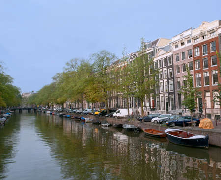gabled house: Typical Amsterdam Canal with many boats.