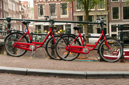 Red bikes parked on a street in Amsterdam, Netherlands. photo