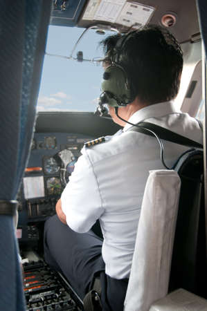 Pilot in a small plane cockpit preparing for Take off. photo