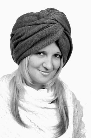 Beautiful young woman wearing winter knitten turban. photo