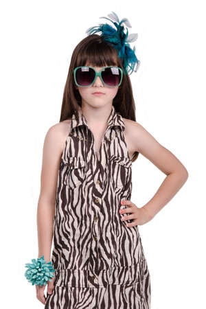 Fashionable little girl against white background photo