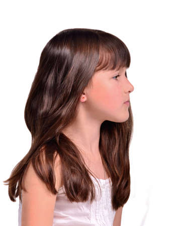 petite: Profile portrait of little girl with long health beautiful hair isolated Stock Photo