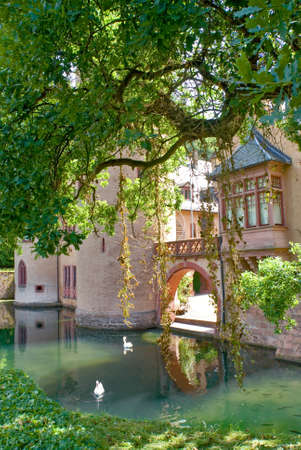 a beautiful old castle surrounded by a mote  in a romantic setting. Editorial