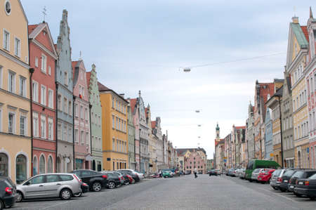 both sides: Cobbled street in Bavaria with cars parked on both sides Stock Photo