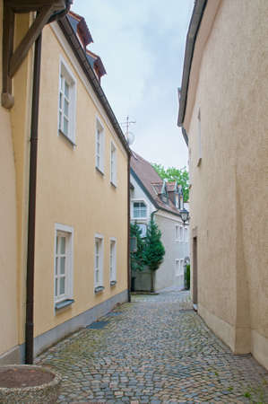 paved: Narrow cobbled street in Bavaria. Stock Photo