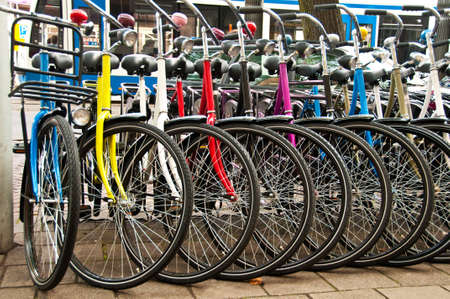 Row of parked colorful bicycles. Editoriali