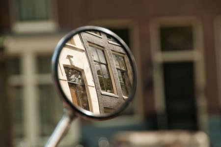 gabled house: City windows reflecting in bike. Stock Photo