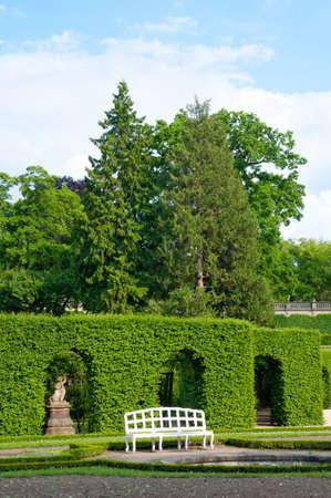 White bench in a baroque garden, Wurzburg residenz, Germany. photo