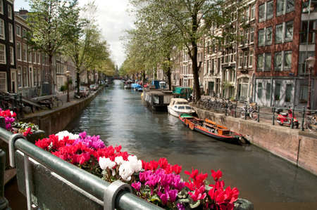 gabled house: View from a bridge to Amsterdam city channel. Stock Photo