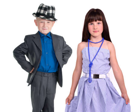 arms akimbo: Elegant pair - little girl and boy isolated on white background