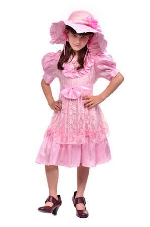Serious girl wearing pink dress and hat isolated on white background Stock Photo - 11696750