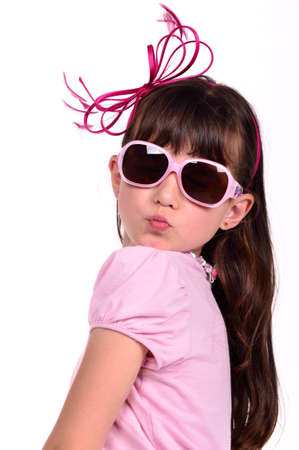 blow kiss: Portrait of lovely girl wearing pink dress and glasses, blowing a kiss, isolated on white backgorund