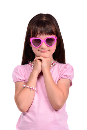 Young coquette girl wearing pink dress and glasses isolated on white background photo