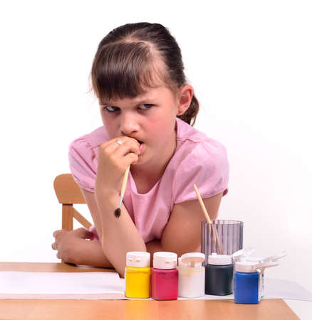 difficult task: Sad girl waiting for inspiration wishing to paint a picture isolated on white background.