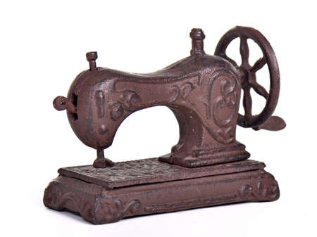 stitching machine: Antique sewing machine, isolated on white background