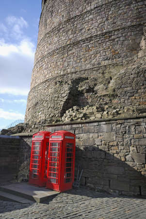 Traditional red telephone box on the wall of Edinburgh Castle photo