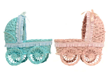 baby carriage: Two old vintage strollers - for boy and girl, isolated