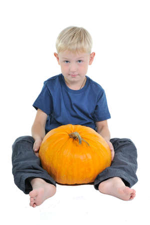 Child with pumpkin isolated photo
