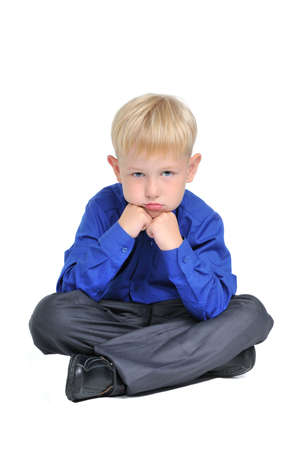 lost child: Portrait of sad thoughtful boy, isolated on white Stock Photo