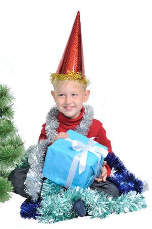 Child holding Christmas gift box, isolated on white background photo