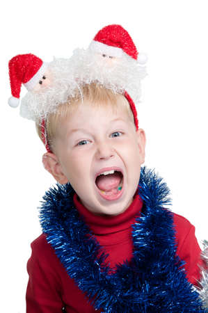 Child with Christmas accessories screaming, studio shot photo