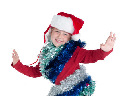 Happy little boy with Santa hat dancing isolated photo