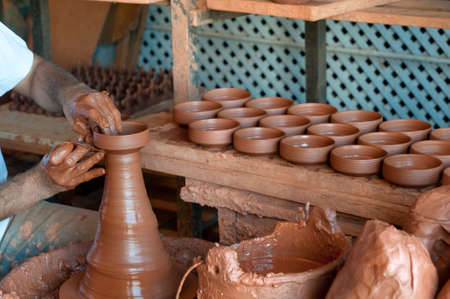 Potter's hands, creating an earthen jar on the spinning wheel